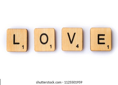 LONDON, UK - JUNE 28TH 2018: The word LOVE, spelt with wooden letter Scrabble tiles, on 28th June 2018.