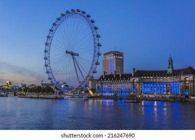 LONDON, UK - JUNE 3, 2013: View of the London Eye at night. London Eye - a famous tourist attraction over river Thames in the capital city London.