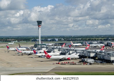 LONDON, UK - JUNE 3, 2017:  View from the air of planes at Terminal 3 of London's Heathrow Airport on a summer morning.  Virgin Atlantic, Delta and American Airlines all use this part of the airport.