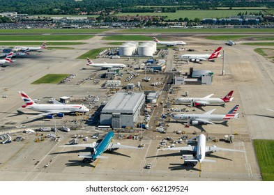 LONDON, UK - JUNE 3, 2017:  Airliners near the northern fuel supplies at London's Heathrow Airport on a sunny morning.  Airlines include British Airways, American Airlines, Cathay Pacific and Qantas.
