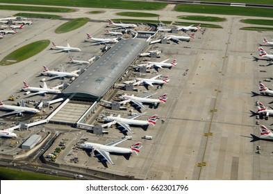 LONDON, UK - JUNE 3, 2017:  Aerial view of British Airways planes parked at Terminal 5 of London's Heathrow Airport on a sunny summer morning.