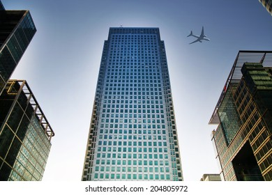 LONDON, UK - JUNE 30, 2014:  Aircraft over the London's skyscrapers going to land in the City airport