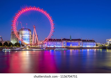 London, UK - June 30, 2018: riverbank of thames river with the Europe's tallest Ferris wheel, london eye