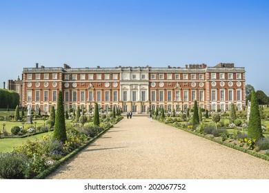 LONDON, UK - JUNE 4, 2013: View of Hampton Court Palace in London. Hampton Court was originally built for Cardinal Thomas Wolsey, a favorite of King Henry VIII, circa 1514.