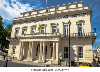 LONDON , UK - JUNE 4, 2015:  Closed  gentlemen's club The Athenaeum at the corner of 107 Pall Mall and St. James's streets.  Part of building copied from the Parthenon in Athens.