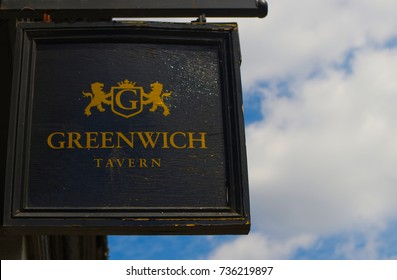 LONDON, UK - June 4, 2015: The black wooden vintage signboard of Greenwich Tavern, old traditional pub and restaurant in Greenwich.