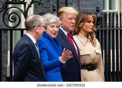 London, UK - June 4 2019: PM Theresa May,Philip May,President Donald Trump and First Lady Melania Trump stand on the steps of 10 Downing Street. This is day two of the US Presidents state visit.