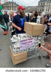 London, UK - June 4 2019: A man is selling Donald Trump toilet paper at the anti Trump protest on Trafalgar Square