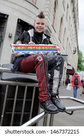 """London, UK - June 4 2019: Young woman fighting for gay rights at the """"together against Trump"""" rally in central London"""
