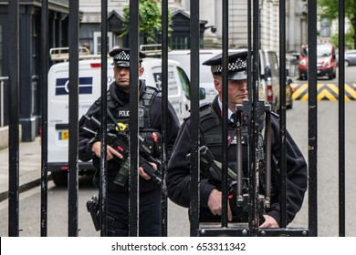 LONDON UK  - JUNE 4th, 2017: Armed Police guard the Gates into Downing Street in Westminster, London. Outside the Residence of the United Kingdom's Prime minister in the heart of Westminster, London.