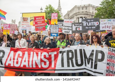 LONDON, UK - June 4th 2019: Large crowds of protesters gather in central London to demonstrate against President Trump's state visit to the UK