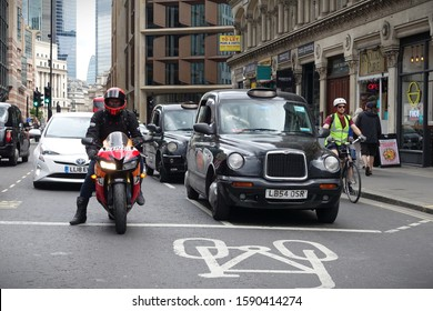 London, UK - June 5, 2019: Traffic passes along a busy road in the City of London.