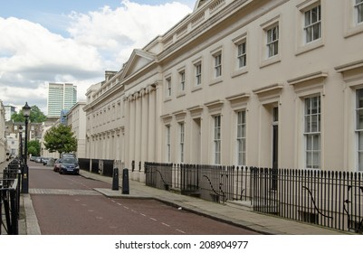 LONDON, UK - JUNE 7, 2014: View along a street of Regency buildings near Regent's Park in Marylebone with the landmark Euston Tower in the distance.