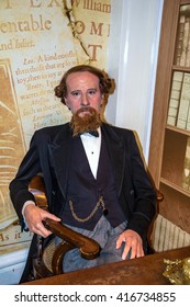LONDON, UK -JUNE 7,2015: Wax figure of  world-famous British writer Charles Dickens at Madame Tussauds museum.