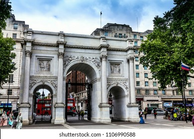 LONDON, UK - JUNE 9, 2015: The Marble Arch monument and gates with Oxford Street beyond West End