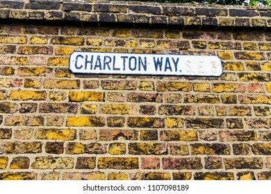 LONDON, UK - JUNE 9, 2015: Street sign on brick wall marking London's famous Charlton way. The local council responsible for Charlton Way is Greenwich London Boro Council