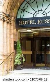 """London, UK - June 9, 2015: Main entrance of Famous Four star Hotel Russell on Russell Square. Hotel Russell was built in 1898 by Charles Fitzroy Doll in style """"tea with milk"""" terracotta."""