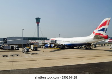 LONDON, UK - JUNE 9, 2016:  A British Airways jumbo jet at a stand at London Heathrow Airport Terminal 5 on a sunny Summer morning.