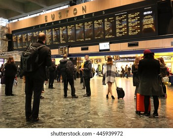 LONDON, UK:  JUNE:  Travelers watching the information departure boards for their gate number at the Euston Railway Station as seen on June 1, 2016.