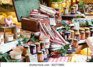 LONDON, UK - MAR 16, 2015: Great selection of salami and jam. Photo taken in a street market, Borough Market in London.