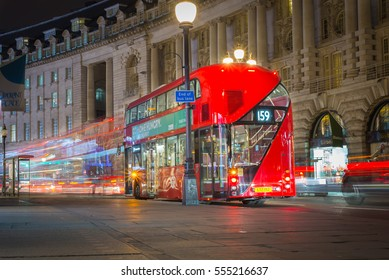 LONDON, UK - MAR 23, 2016 : Photo of Red bus on Regent street road at night , This street is famous for shopping. Beautiful architecture London, England