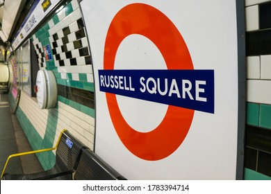 London, UK - March 1, 2020: A Russell Square tube station sign on the wall of a Russell Square tube platform in London, UK