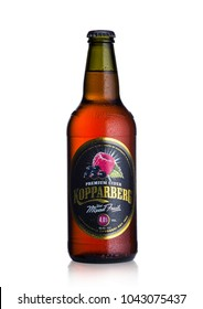 LONDON, UK - MARCH 10, 2018 : Cold Bottle of Kopparberg premium cider with mixed fruit flavor on white background.