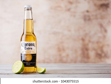 LONDON, UK - MARCH 10, 2018 : Bottles of Corona Extra Beer with lime slice on wooden background.Corona is the most popular imported beer in the US.