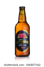 LONDON, UK - MARCH 10, 2018 : Cold Bottle of Kopparberg premium cider with raspberry flavor on white background.
