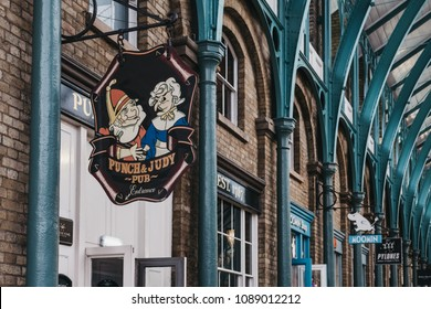 London, UK - March 10, 2018: Sign at the entrance of Punch & Judy pub in Covent Garden Market, one of the most popular tourist sites in London, UK.