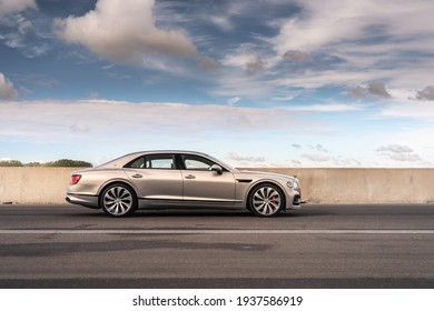London, UK- March 10, 2021: A silver Bentley Flying Spur blackline limousine is parked on road