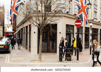 London, UK / March 11 2018: British flags on the building of Radisson Blu Edwardian Hotel on Mercer street, Seven Dials intersection, London. One of the most iconic location in London.