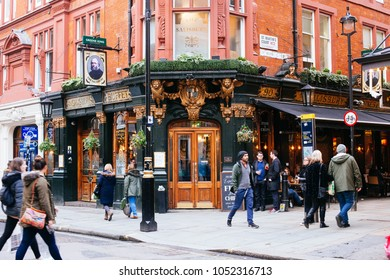 London, UK / March 11 2018: tourists walking in front of Salisbury buffet on St Martins Court in London, UK