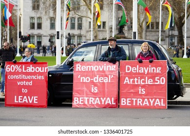 London, UK. - March 11, 2019: Leave supporters campaign in Parliament Square in front of a taxi, with less than three weeks before the U.K. is dues to leave the E.U.