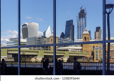 LONDON, UK - MARCH 11 : City skyline reflected in a building on the south bank of the River Thames in London on March 11, 2019. Unidentified people