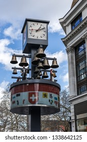 LONDON, UK - MARCH 11 : Clock tower and bells at the entrance to Leicester Square in London on March 11, 2019