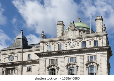 LONDON, UK - MARCH 11 : Historical building on the corner of Piccadilly Circus in London on March 11, 2019