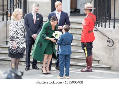 LONDON, UK - March 11: Meghan Markle and Prince Harry receive flowers after leaving Canada House on the March 11, 2019 in London, UK