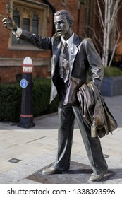 LONDON, UK - MARCH 11 : Statue of an office worker hailing a cab on John Carpenter Street near Victoria embankment in London on March 11, 2019