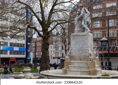 LONDON, UK - MARCH 11 : Statue of Shakespeare in Leicester Square London on March 11, 2019. Unidentified people