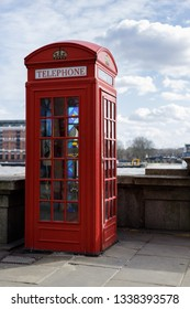 LONDON, UK - MARCH 11 : Traditional Red telephone box with stained glass windows on Victoria Embankment  in London on March 11, 2019