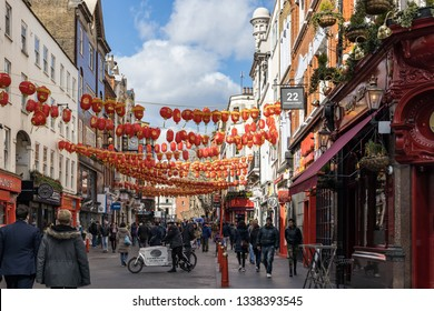 LONDON, UK - MARCH 11 : View of Chinatown in Soho London on March 11, 2019. Unidentified people