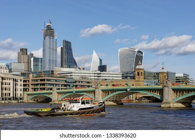 LONDON, UK - MARCH 11 : View along the River Thames towards the City of London on March 11, 2019