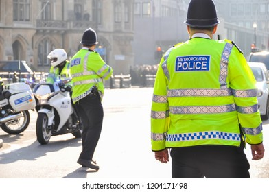 LONDON, UK - MARCH 12, 2012: Policemen secure the Westminster Abbey area for the Commonwealth Day ceremony attended by Queen Elizabeth II.