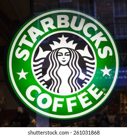 LONDON, UK - MARCH 12TH 2015: The Starbucks sign on a window of one of the companys coffeehouses in London on 12th March 2015.