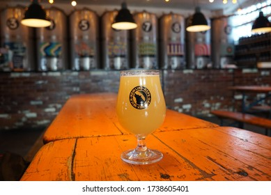 London / UK - March 13 2020: Glass of craft beer in a brewery taproom bar in Hackney Wick, east London