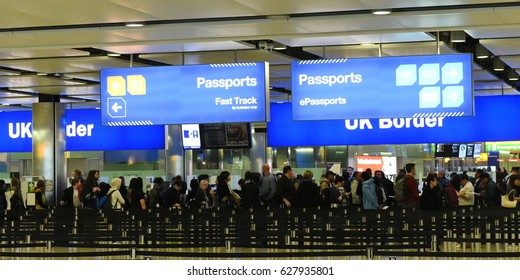London, UK - March 14, 2017: Air travelers queue at border control at Heathrow Airport. Passengers from the EU face uncertainty as the UK government is poised to trigger article 50 to initiate brexit.