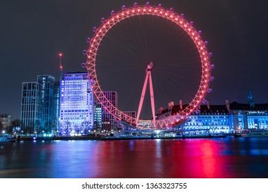 London, UK - March 14, 2019: Photo of  world famous landmark London Eye taken at night time - Slow shutter speed photography