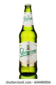 LONDON, UK - MARCH 15, 2017: Bottle of Staropramen premium beer on white background with reflection. Staropramen brewery was founded in Praque in 1869.