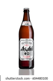LONDON, UK - MARCH 15, 2017: Bottle of Asahi Lager beer on white background with reflection, Made by Asahi Breweries, Ltd in Japan since 1889.